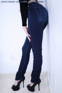 In high heels and jeans