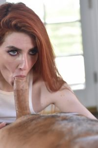 Redhead beauty blows hard cock