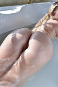 Uncovered ass in bathtub